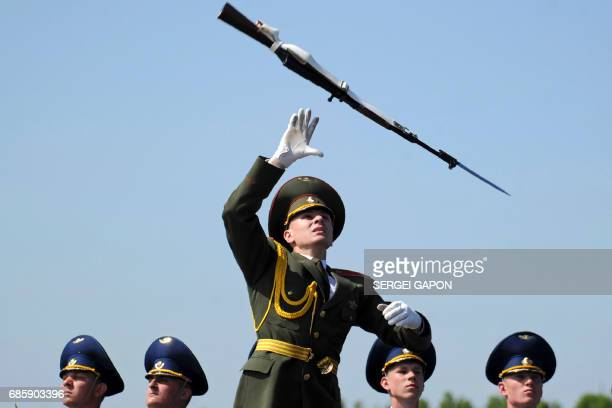 Belarusian honour guard performs during the opening ceremony of the 8th International military exhibition MILEX2017 on May 20 2017 in Minsk About 140...