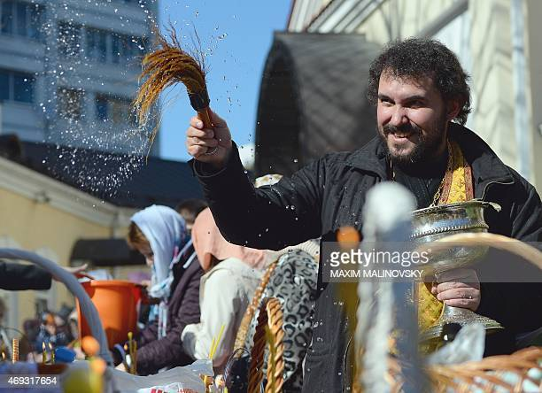 A Belarusian Orthodox priest blesses Easter cakes and coloured eggs during a ceremony in Minsk on April 11 on the eve of Orthodox Easter celebrations...