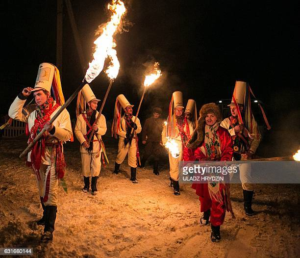 Belarusian people perform during a celebration of 'Tsari' rite in the village of Semezhevo some 160 km southwest of Minsk on January 2017 That rite...