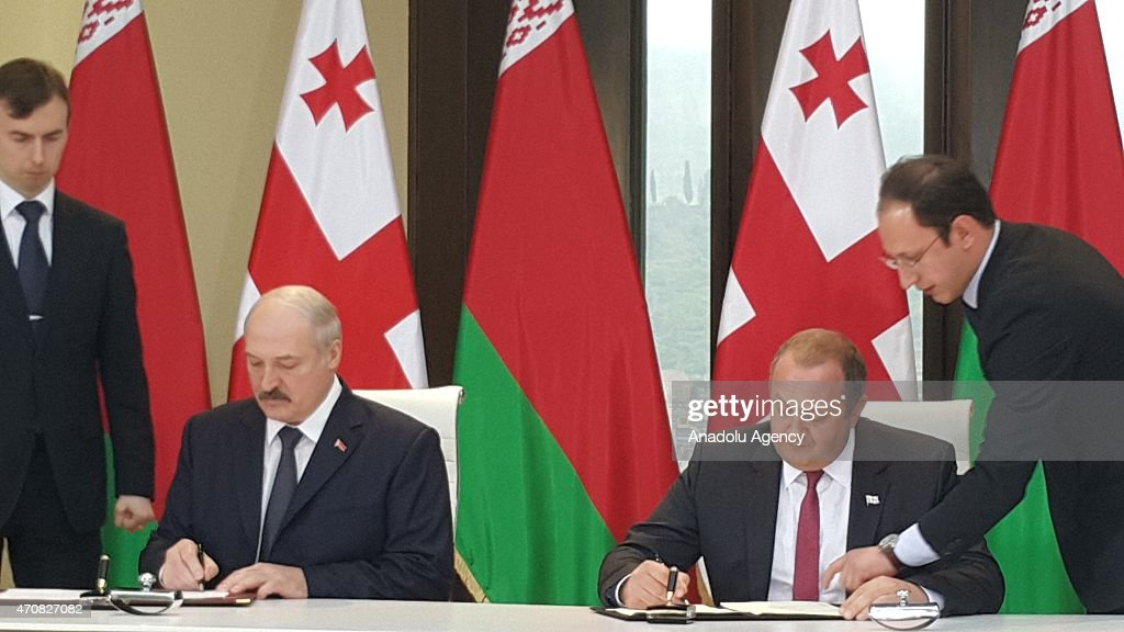 Belarusian President <a gi-track='captionPersonalityLinkClicked' href=/galleries/search?phrase=Alexander+Lukashenko&family=editorial&specificpeople=542572 ng-click='$event.stopPropagation()'>Alexander Lukashenko</a> (L 2) and Georgian President <a gi-track='captionPersonalityLinkClicked' href=/galleries/search?phrase=Giorgi+Margvelashvili&family=editorial&specificpeople=10916956 ng-click='$event.stopPropagation()'>Giorgi Margvelashvili</a> (R 2) sign agreements at the presidential palace in Tbilisi, Georgia on April 23, 2015.