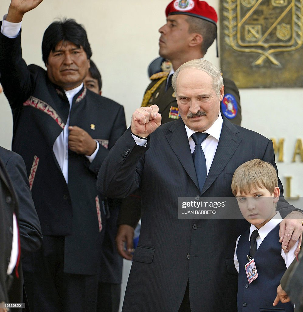 Belarusian President Alexander Lukashenko (R) and his son Nikolai wave next to Bolivian President Evo Morales(L) after the funeral of late Venezuelan President Hugo Chavez in Caracas, on March 8, 2013. Latin American leaders and US foes paid tribute to Venezuelan leader Hugo Chavez on Friday as he lay in state in a flag-draped coffin during a lavish state funeral before the nation swears-in an interim president.