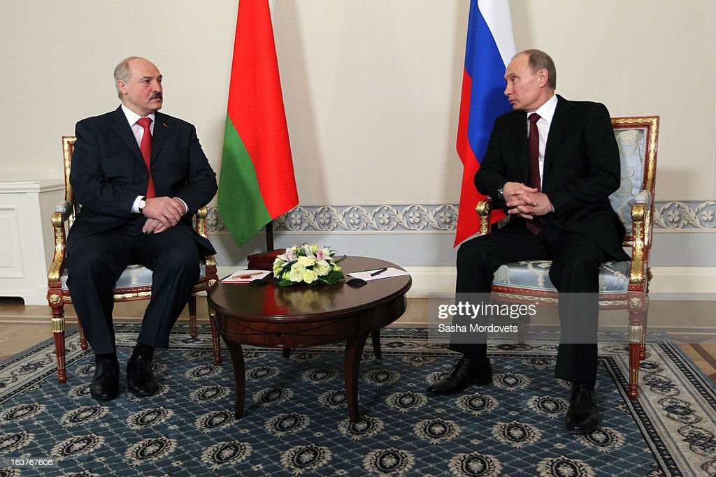 Belarusian President Alexander Lukashenko (L) and Russian President Vladimir Putin attend a meeting at Konstantinovsky Palace on March 15, 2013 in Saint Petersburg, Russia. Putin and Lukashenko met as part of the Union State's Supreme State Council summit.