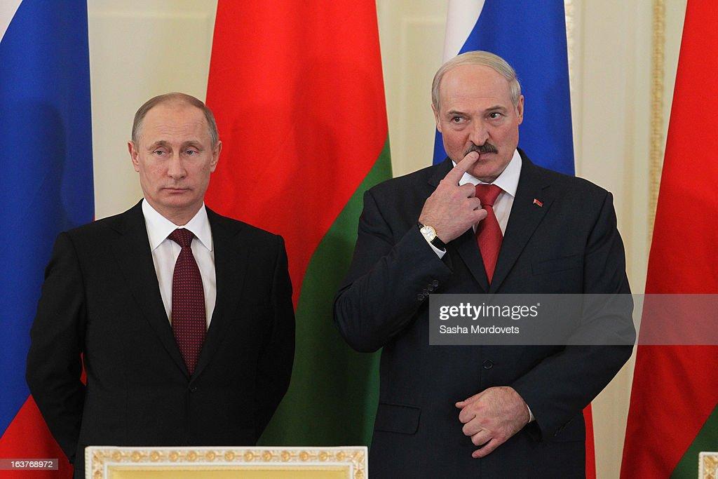 Belarusian President Alexander Lukashenko and Russian President Vladimir Putin attend a meeting at Konstantinovsky Palace on March 15 2013 in Saint...