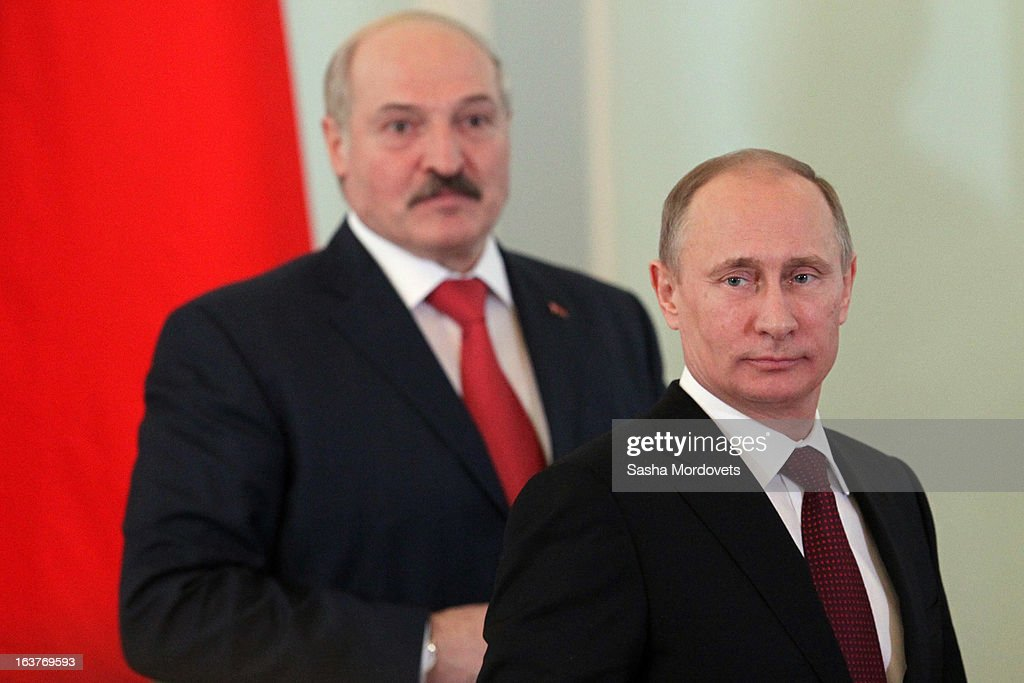 Belarusian President <a gi-track='captionPersonalityLinkClicked' href=/galleries/search?phrase=Alexander+Lukashenko&family=editorial&specificpeople=542572 ng-click='$event.stopPropagation()'>Alexander Lukashenko</a> (L) and Russian President <a gi-track='captionPersonalityLinkClicked' href=/galleries/search?phrase=Vladimir+Putin&family=editorial&specificpeople=154896 ng-click='$event.stopPropagation()'>Vladimir Putin</a> attend a meeting at Konstantinovsky Palace on March 15, 2013 in Saint Petersburg, Russia. Putin and Lukashenko met as part of the Union State's Supreme State Council summit.