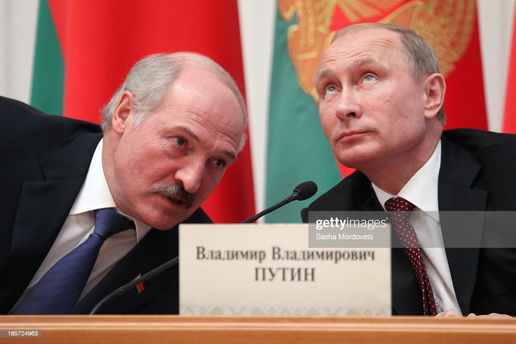 Belarusian President Alexander Lukashenko and Russian President Vladimir Putin attend a meeting October 24 2013 in Minsk Belarus Leaders of Russia...