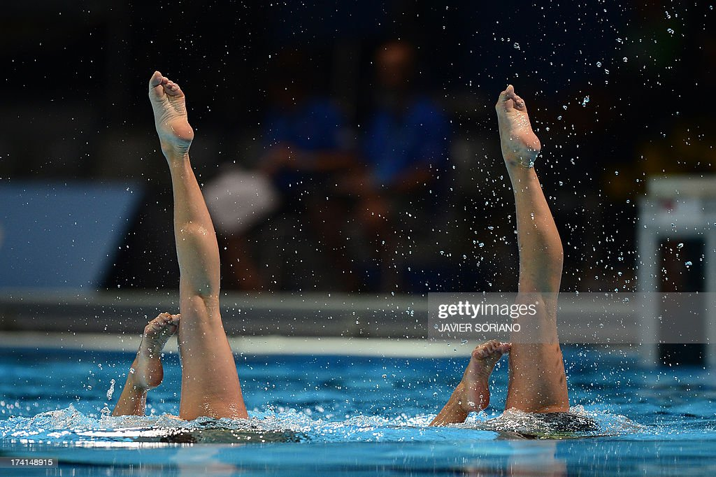 Belarus's Iryna Limanouskaya and Iya Zhyshkevich compete in the duet technique preliminary round during the synchronised swimming competition in the FINA World Championships at the Palau Sant Jordi in Barcelona, on July 21, 2013.