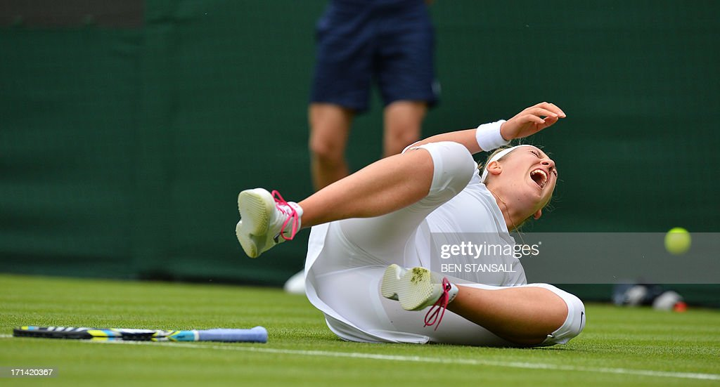 Belarus's Victoria Azarenka falls on court during a point against Portugal's Maria Joao Kohler during their women's first round match on day one of the 2013 Wimbledon Championships tennis tournament at the All England Club in Wimbledon, southwest London, on June 24, 2013. AFP PHOTO / BEN STANSALL - RESTRICTED TO EDITORIAL USE