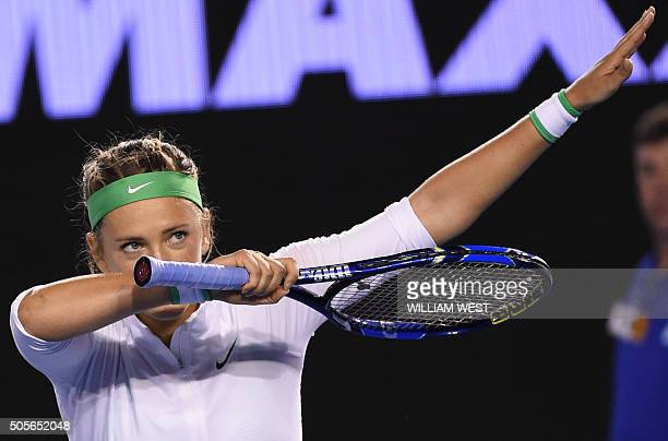 Belarus's Victoria Azarenka gestures as she celebrates after victory in her women's singles match against Belgium's Alison Van Uytvanck on day two of...