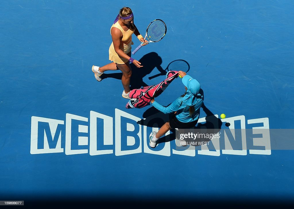 Belarus's Victoria Azarenka receives a towel during her women's singles match against Russia's Svetlana Kuznetsova on day ten of the Australian Open tennis tournament in Melbourne on January 23, 2013.
