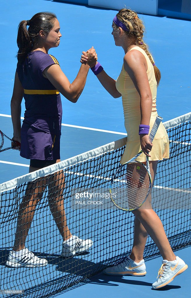 Belarus's Victoria Azarenka (R) shakes hands after victory in her women's singles match against Jamie Hampton of the US on the sixth day of the Australian Open tennis tournament in Melbourne on January 19, 2013.