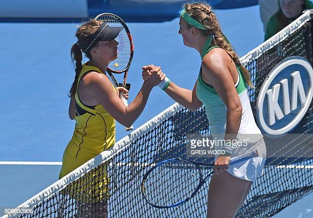 Belarus's Victoria Azarenka shakes hands after victory in her women's singles match against Czech Republic's Barbora Strycova on day eight of the...