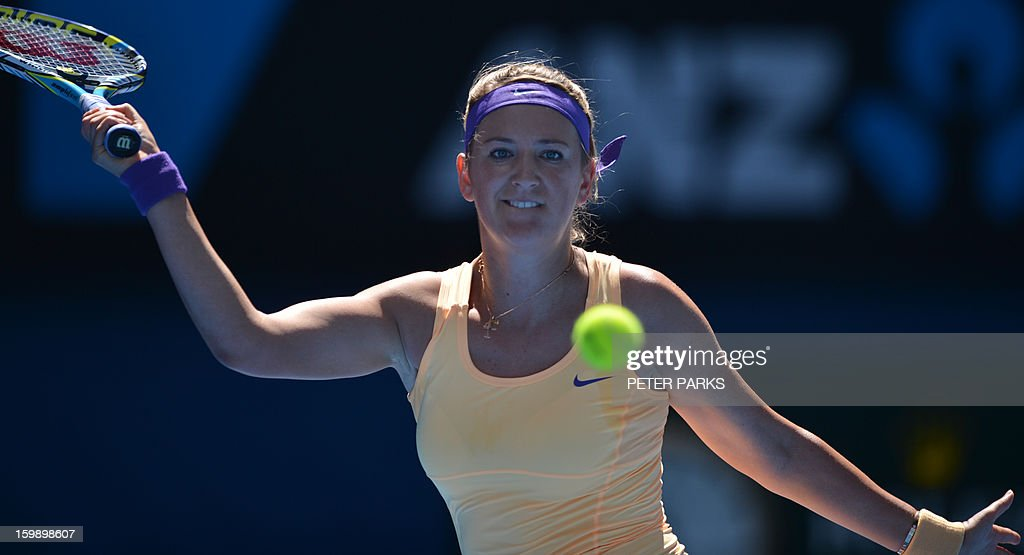 Belarus's Victoria Azarenka watches the ball as she plays a return during her women's singles match against Russia's Svetlana Kuznetsova on the tenth day of the Australian Open tennis tournament in Melbourne on January 23, 2013.