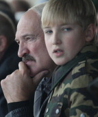 Belarussian President Alexander Lukashenko and his son Nikolai watch joint RussianBelarussian military exercises at the polygon on September 26 2013...