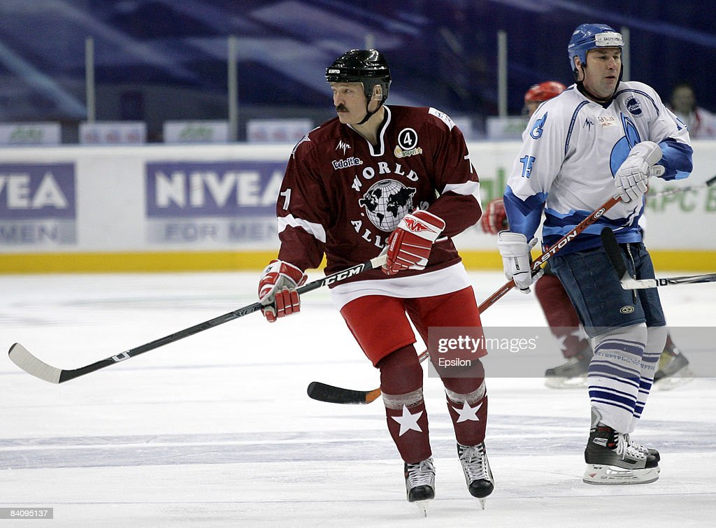 Belarussian President Alexander Lukashenko (L) in action during the match between World Ice Hockey Stars and HC Gazprom Export at the Megasport Arena on December 19, 2008 in Moscow, Russia. The friendly match was dedicated to the legendary hockey coach, Anatoly Tarasov of Russia.