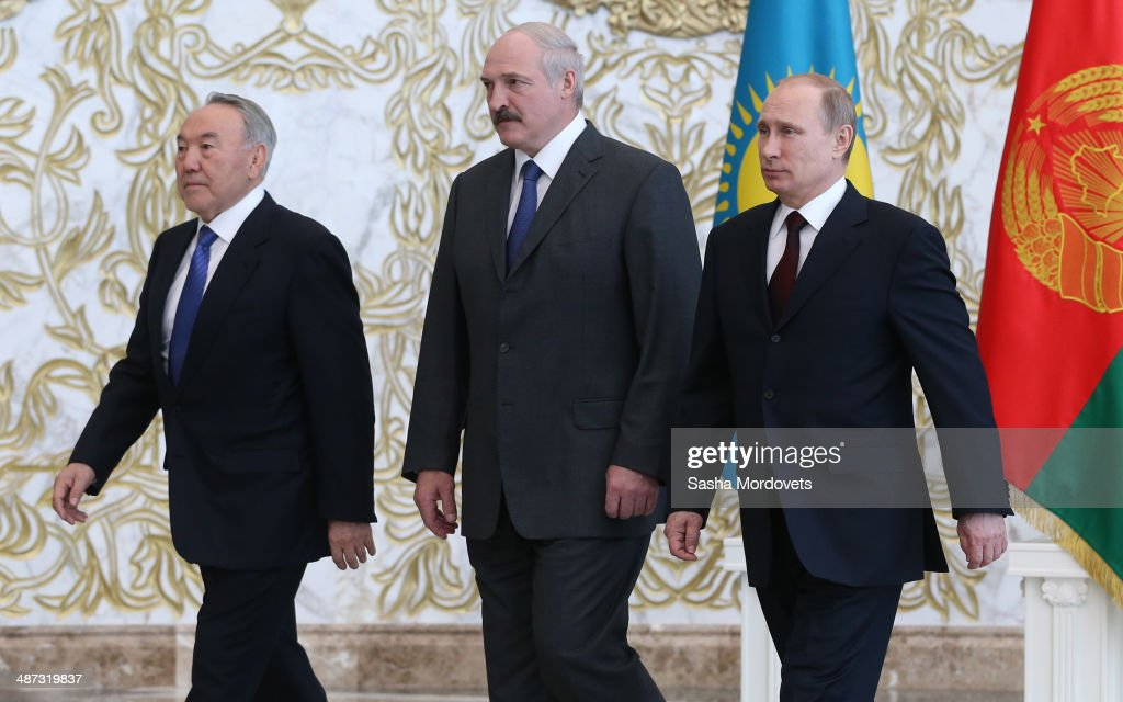Belarussian President <a gi-track='captionPersonalityLinkClicked' href=/galleries/search?phrase=Alexander+Lukashenko&family=editorial&specificpeople=542572 ng-click='$event.stopPropagation()'>Alexander Lukashenko</a>, Kazakh President <a gi-track='captionPersonalityLinkClicked' href=/galleries/search?phrase=Nursultan+Nazarbayev&family=editorial&specificpeople=4556028 ng-click='$event.stopPropagation()'>Nursultan Nazarbayev</a> and Russian President <a gi-track='captionPersonalityLinkClicked' href=/galleries/search?phrase=Vladimir+Putin&family=editorial&specificpeople=154896 ng-click='$event.stopPropagation()'>Vladimir Putin</a> attend a meeting of the Eurasian Economic Community on April 29, 2014 in Minsk, Belarus. Leaders of Russia, Kazakhstan and Belarus are gathered for a one-day summit.