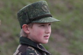 Belarussian President Alexander Lukashenko's son Nikolai watches a joint RussianBelarussian military exercises at the polygon on September 26 2013 in...