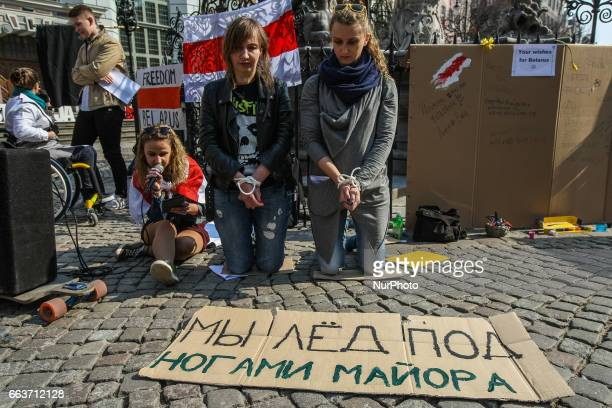 Belarussian protesters with hands tied with a cord are seen in Gdansk Poland on 2 April 2017 Belarussian opposition activists and students living in...