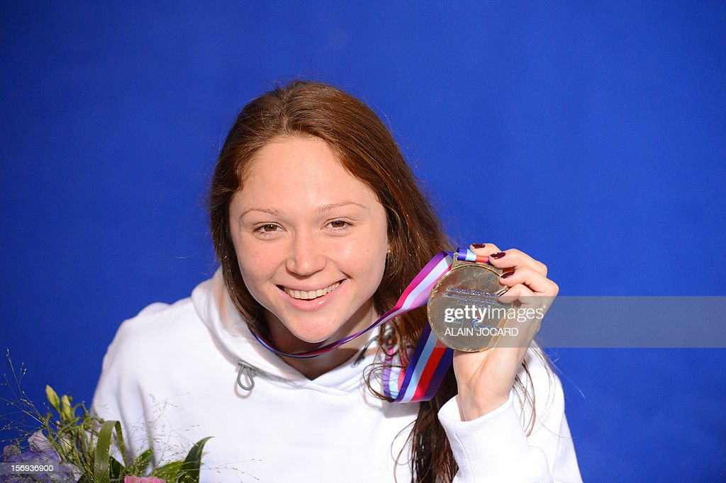 Belarussian swimmer <a gi-track='captionPersonalityLinkClicked' href=/galleries/search?phrase=Aliaksandra+Herasimenia&family=editorial&specificpeople=2077479 ng-click='$event.stopPropagation()'>Aliaksandra Herasimenia</a> poses with her gold medal after winning the women's short course 50 m freestyle final at the European Swimming Championships on November 25, 2012, in Chartres.