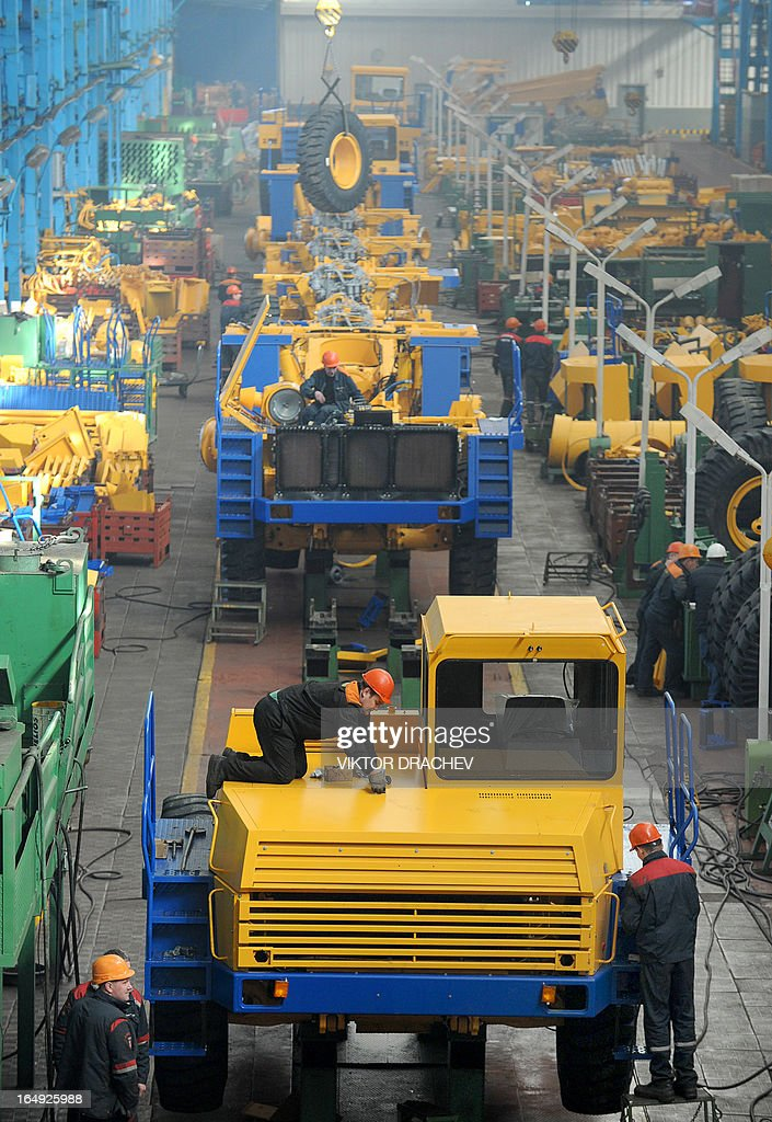 BelAZ dump-trucks of 36 tonnes carrying capacity stand ON assembly line at the BelAZ automobile plant in the Belarus town of Zhodino, some 50km north of the capital Minsk, on March 29, 2013.