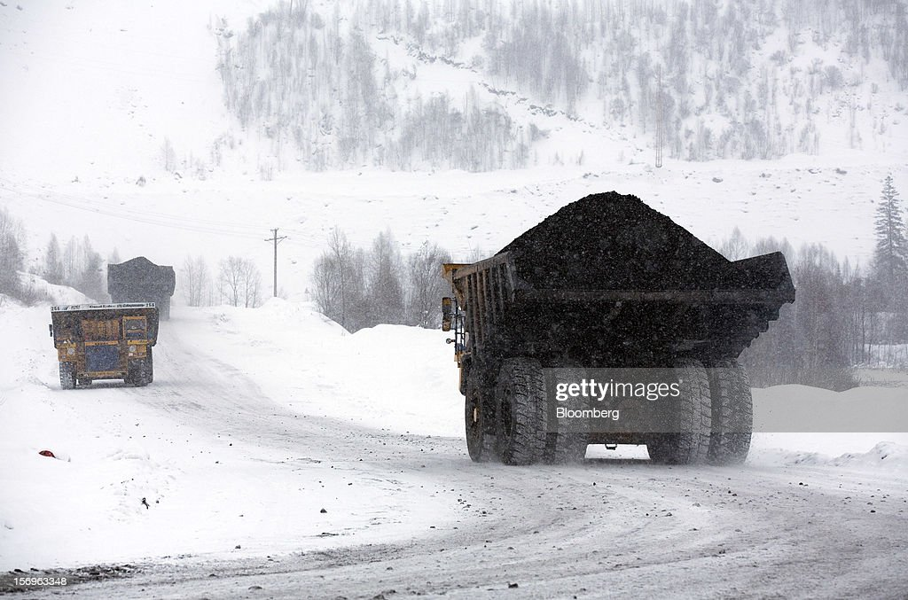 Belaz transporter trucks move freshly excavated coal at the Sibirginsky open pit coal mine, owned by OAO Mechel and operated by Southern Kuzbass Coal Co., near Myski, in Kemerovo region of Siberia, Russia, on Friday, Nov. 23, 2012. OAO Mechel is Russia's biggest maker of steelmaking coal. Photographer: Andrey Rudakov/Bloomberg via Getty Images