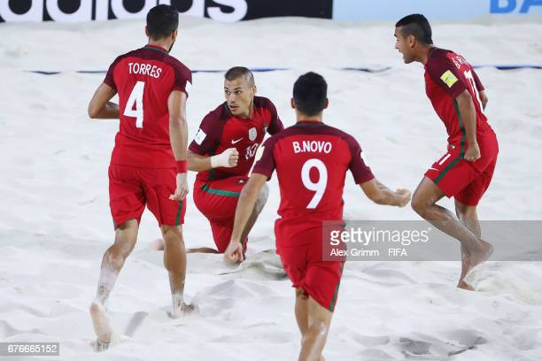 Belchior of Portugal celebrates a goal with team mates Torres Bruno Novo and Madjer during the FIFA Beach Soccer World Cup Bahamas 2017 group C match...