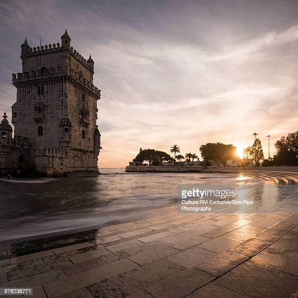 Belem tower at dusk against dramatic sky, Lisbon, Portugal