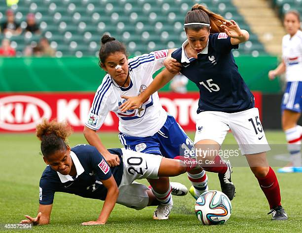 Belen Benitez of Paraguay challenges Fanny Hoarau and Margaux Bueno of France during the FIFA U20 Women's World Cup Canada 2014 Group D match between...