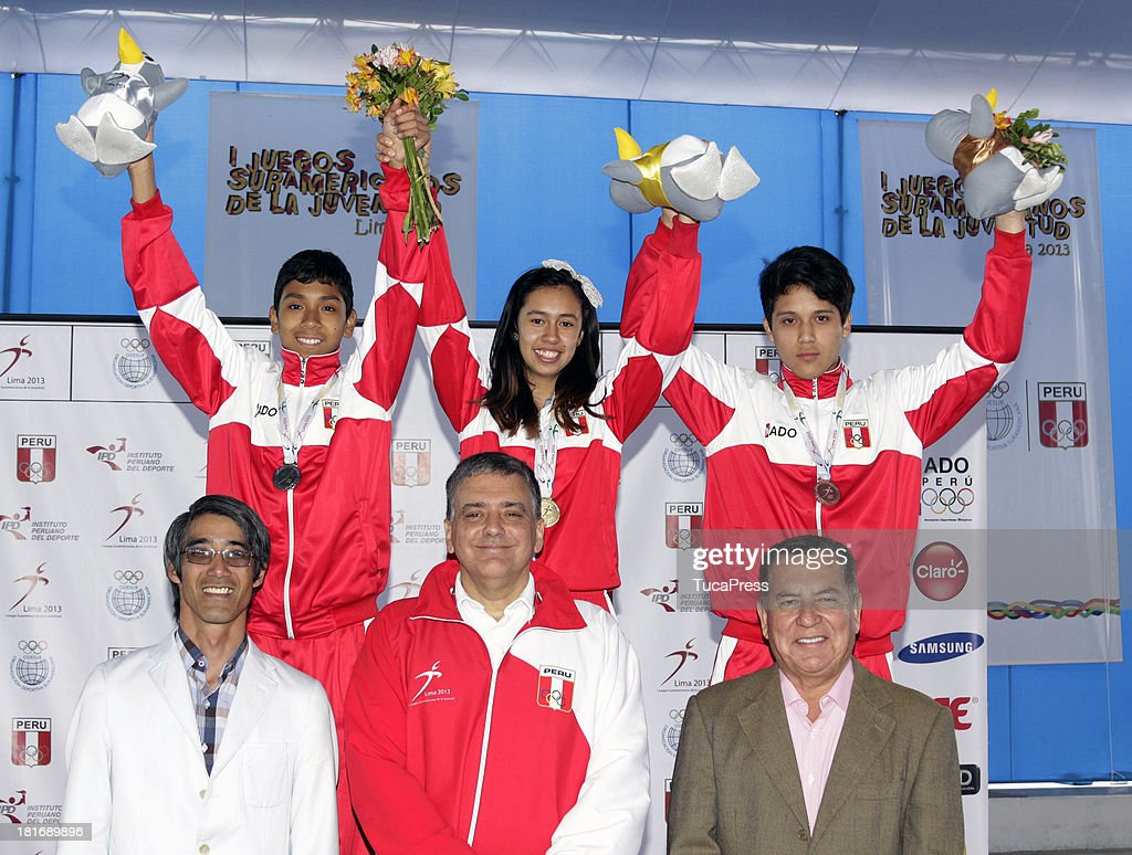 Belen Costa Ortega of Peru, poses with her team and gold medal after winning the 63 kg of Taekwondo as part of the I ODESUR South American Youth Games at on September 22, 2013 in Lima, Peru.