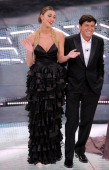 Belen Rodriguez and Gianni Morandi attend the 61th Sanremo Song Festival at the Ariston Theatre on February 17 2011 in San Remo Italy