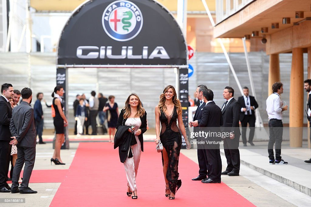 <a gi-track='captionPersonalityLinkClicked' href=/galleries/search?phrase=Belen+Rodriguez&family=editorial&specificpeople=5618507 ng-click='$event.stopPropagation()'>Belen Rodriguez</a> and guest walk the red carpet of Bocelli and Zanetti Night on May 25, 2016 in Rho, Italy.