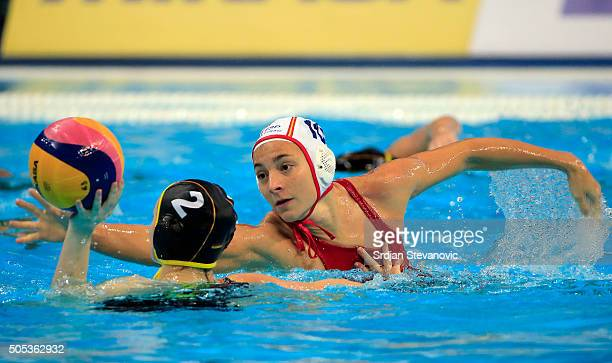 Belen Vosseberg of Germany is challenged by Roser Tarrago of Spain during the Women's Preliminary Group B match between Spain and Germany at the...