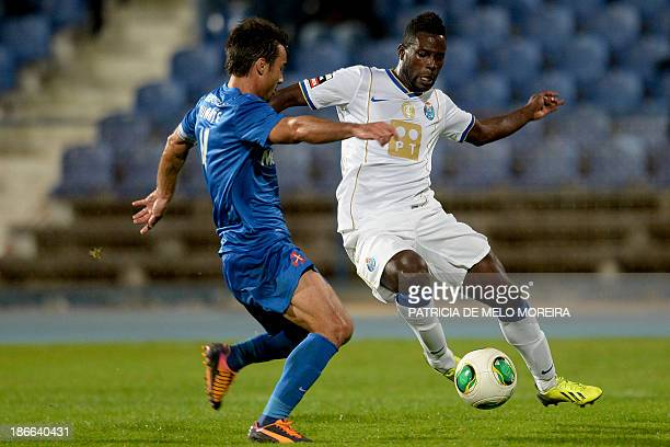 Belenenses' defender Duarte Machado vies with FC Porto's forward Silvestre Varela during the Portuguese league football match Belenses vs FC Porto at...