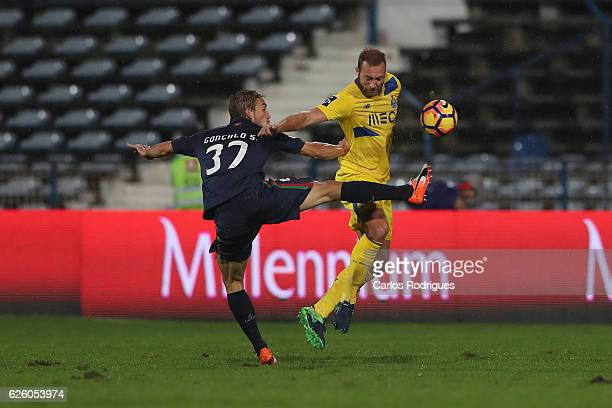 Belenenses' defender Goncalo Silva from Portugal vies with FC Porto's forward Laurent Depoitre from Belgium during the Portuguese Primeira Liga match...