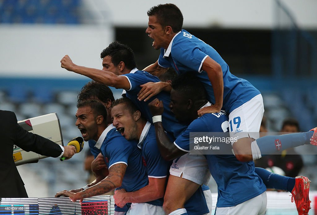 Belenenses midfielder <a gi-track='captionPersonalityLinkClicked' href=/galleries/search?phrase=Carlos+Martins&family=editorial&specificpeople=685923 ng-click='$event.stopPropagation()'>Carlos Martins</a> and teamates celebrate after scoring first goal during the UEFA Europa League Qualifier between Belenenses and IFK Goteborg at Estadio do Restelo on July 30, 2015 in Lisbon, Portugal.