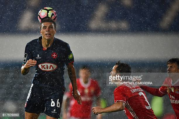 Belenenses' midfielder Joao Palhinha heads the ball during the Portuguese league football match between OS Belenenses and SL Benfica at the Restelo...