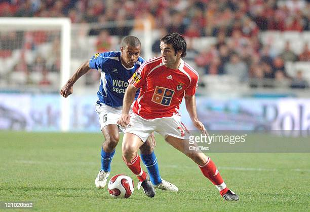 Belenenses' Sandro Gaucho and Benfica's Karagounis in action during their Portuguese Bwin League match December 21 2006 in Lisbon Portugal