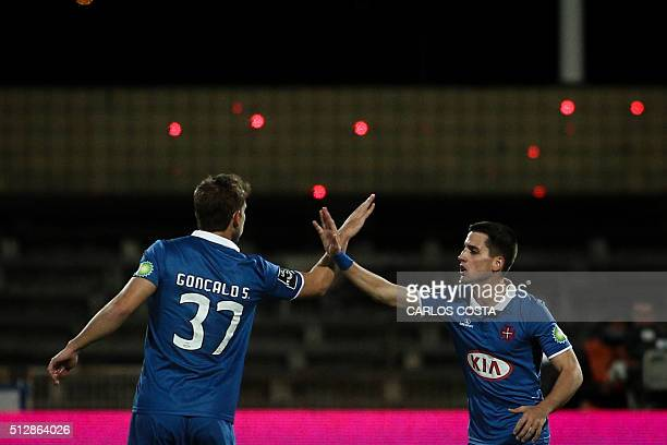 Belenenses' Spanish forward Juanto Ortuno celebrates a goal with Belenenses' defender Goncalo Silva during the Portuguese league football match OS...