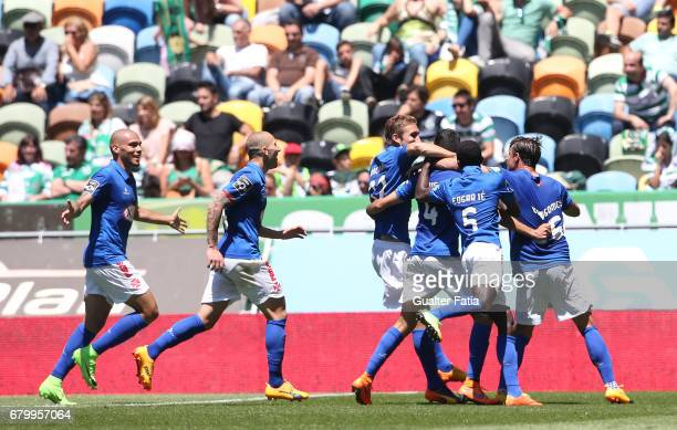 Belenenses's defender Dinis Almeida from Portugal celebrates with teammates after scoring a goal during the Primeira Liga match between Sporting CP...