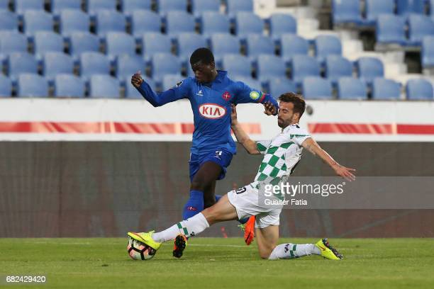 Belenenses's defender Edgar Ie from Portugal with Moreirense«s midfielder Alex in action during the Primeira Liga match between CF Os Belenenses and...