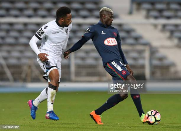 Belenenses's defender Edgar Ie from Portugal with Vitoria Guimaraes forward Hernani Fortes in action during the Primeira Liga match between...