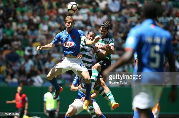 Belenenses's defender Goncalo Silva from Portugal with Sporting CP's defender Ezequiel Schelotto from Argentina and Sporting CP's forward Bryan Ruiz...