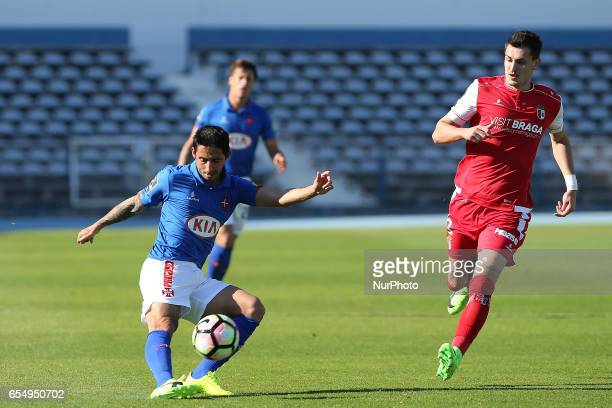Belenensess defender Joao Diogo from Portugal and Bragas defender Lazar Rosic from Serbia during Premier League 2016/17 match between Os Belenenses...