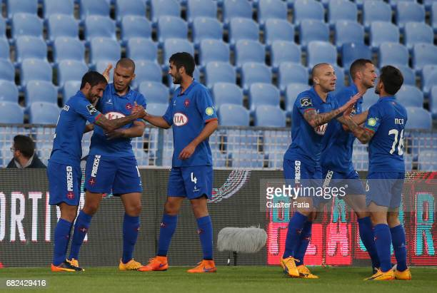 Belenenses's defender Joao Diogo from Portugal celebrates with teammates after scoring a goal during the Primeira Liga match between CF Os Belenenses...