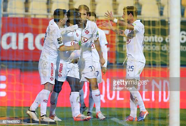 Belenenses's forward Abel Camara from Portugal celebrates with teammates after scoring a goal during the Primeira Liga match between GD Estoril Praia...