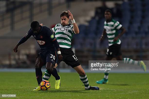Belenenses's forward Abel Camara from Portugal vies with Sporting CPO's defender Sebastian Coates from Uruguay during the Portuguese Primeira Liga...