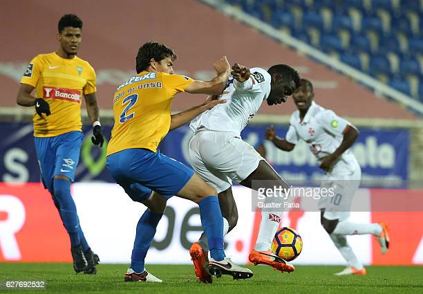 Belenenses's forward Abel Camara from Portugal with Estoril's defender Joao Afonso in action during the Primeira Liga match between GD Estoril Praia...