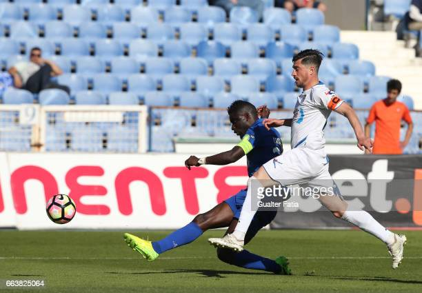 Belenenses's forward Abel Camara from Portugal with Feirense's midfielder Cris Santos from Portugal in action during the Primeira Liga match between...