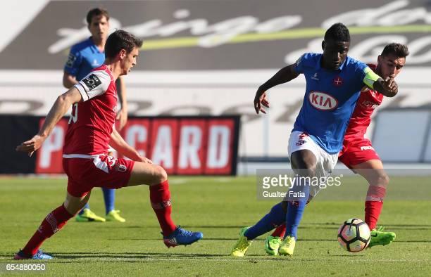 Belenenses's forward Abel Camara from Portugal with SC Braga's Serbian midfielder Nikola Vukcevic and SC Braga's Portuguese forward Ricardo Horta in...