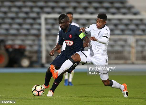Belenenses's forward Abel Camara from Portugal with Vitoria Guimaraes midfielder Bongani Zungu in action during the Primeira Liga match between...