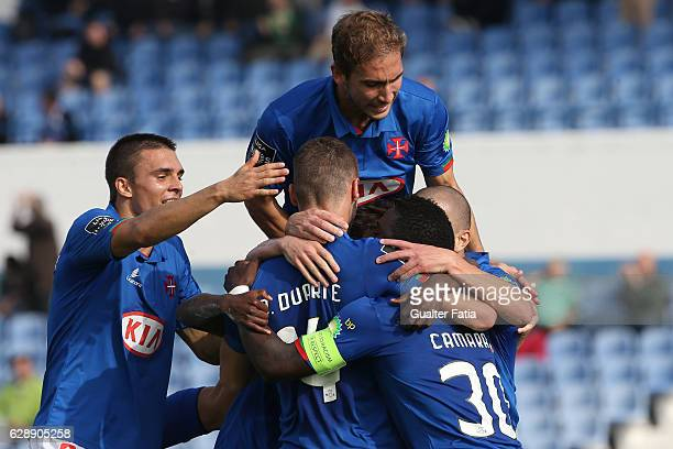 Belenenses's forward Gerso from Portugal celebrates with teammates after scoring a goal during the Primeira Liga match between CF Os Belenenses and...